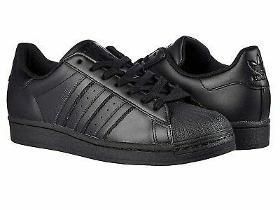 man s sneakers and athletic shoes superstar